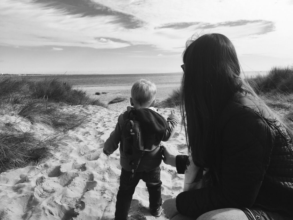 A mum and toddler on Studland beach in Dorset