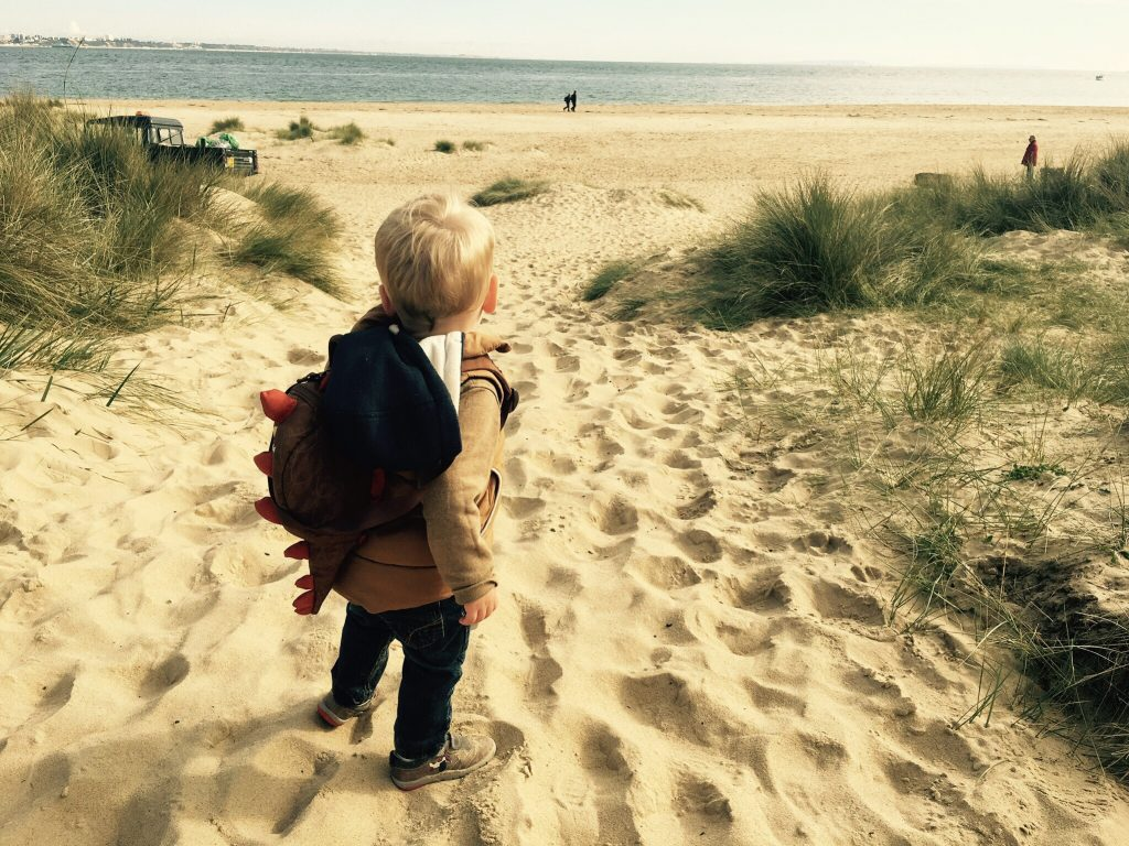 A toddler on Studland beach in Dorset