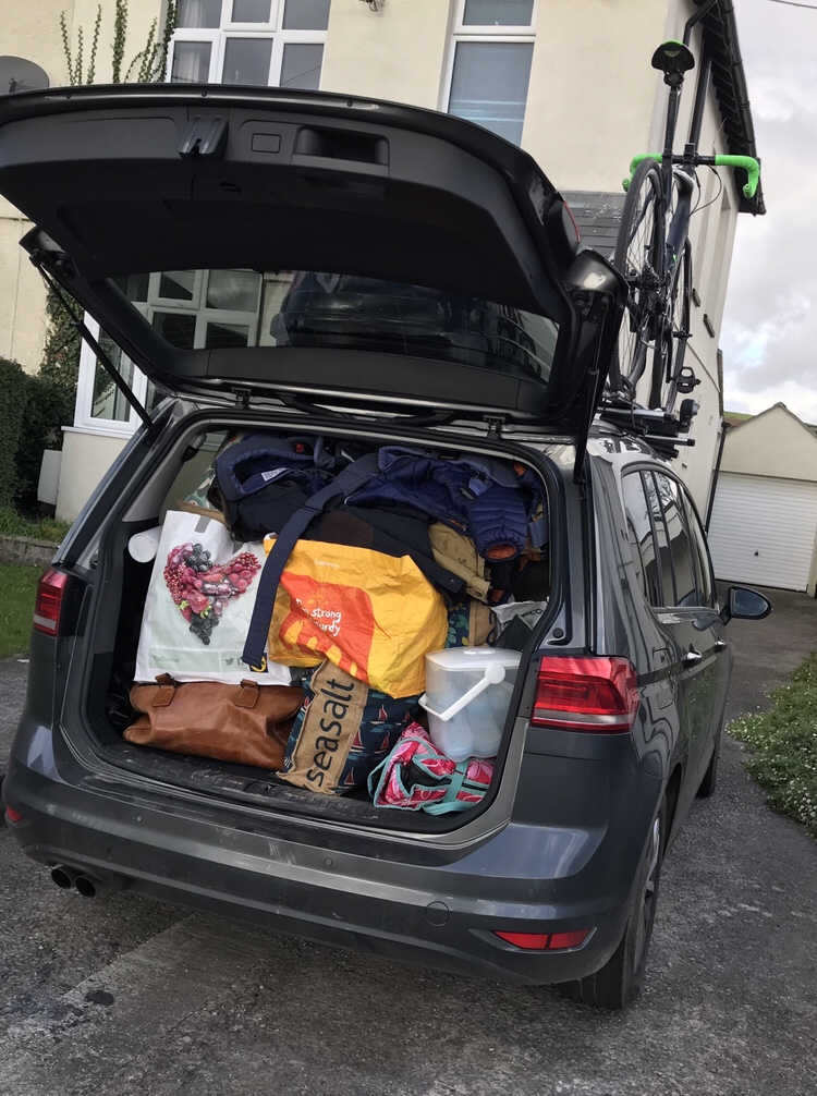 A VW touran packed to the roof with things for looking after twins