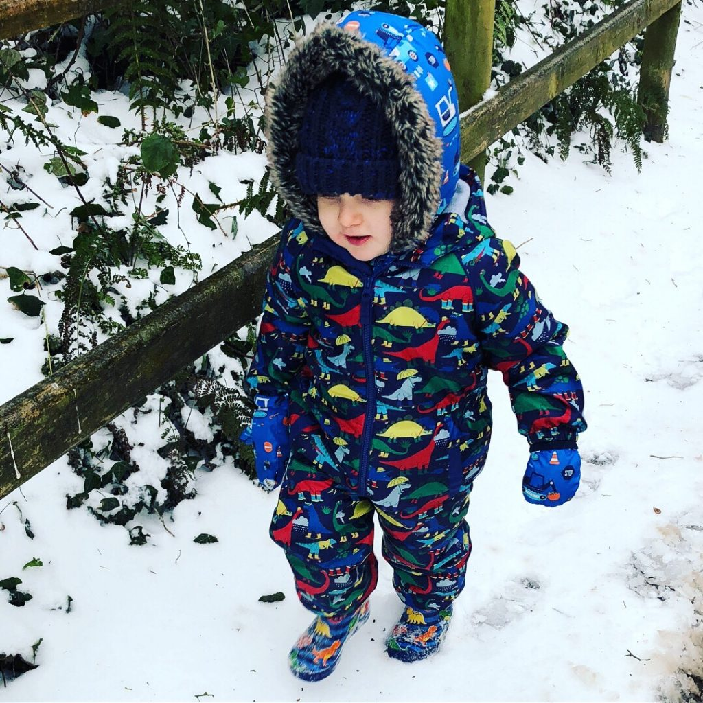 Toddler playing in the snow