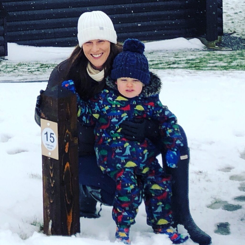 Mum and toddler in the snow