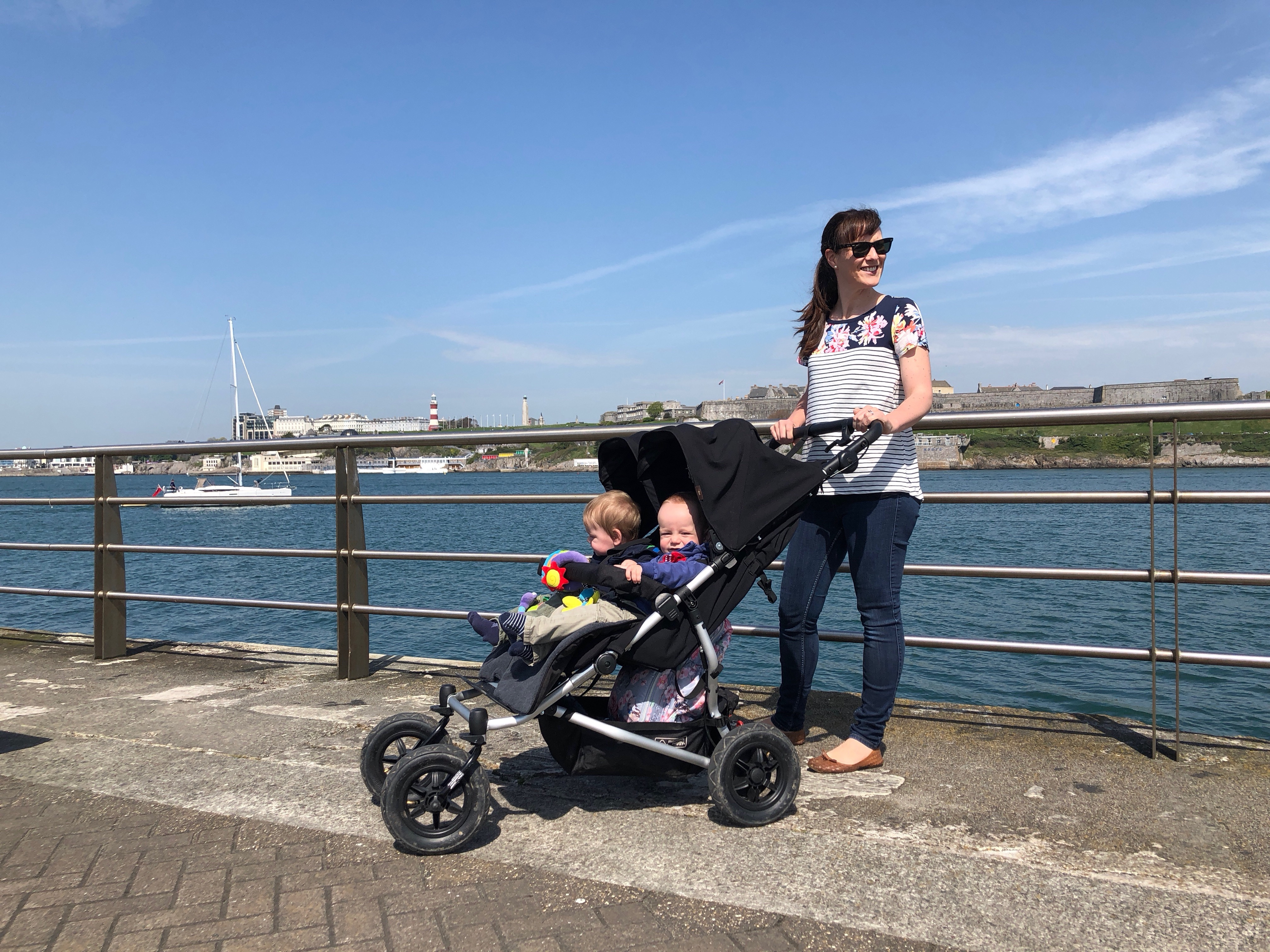 Mum with twins in a buggy by the sea in Plymouth