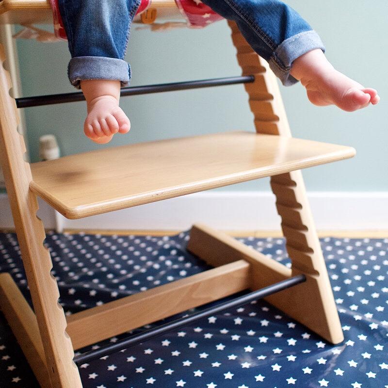 Messy Me splash mat underneath a high chair