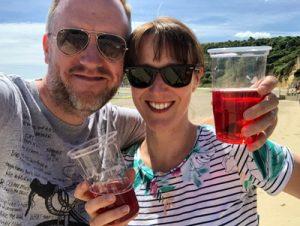 A couple enjoying a drink on the beach