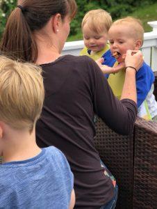 Mum feeding baby twins on holiday