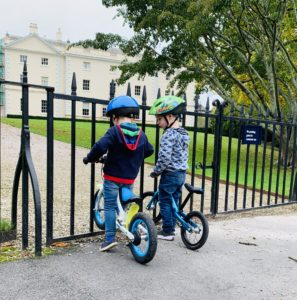 toddlers on bikes at National Trust Saltram