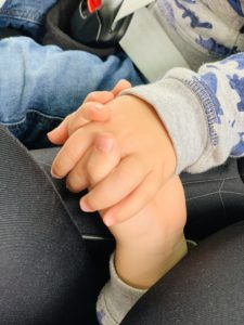 twins and toddler holding hands asleep