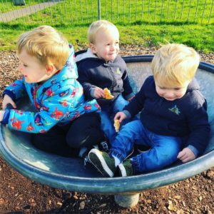 toddler and twins at park