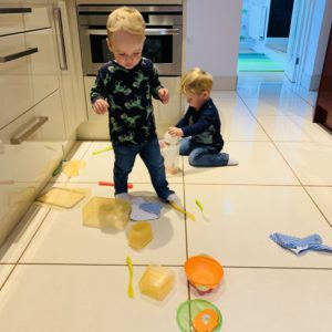 twins ransacking cupboards