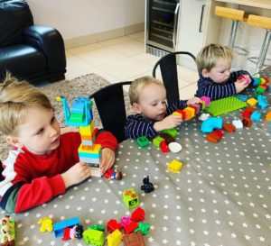 toddler and twins with duplo