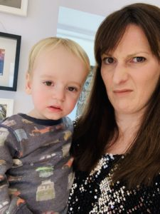 Snotty twin wants a cuddle when mum is dressed up