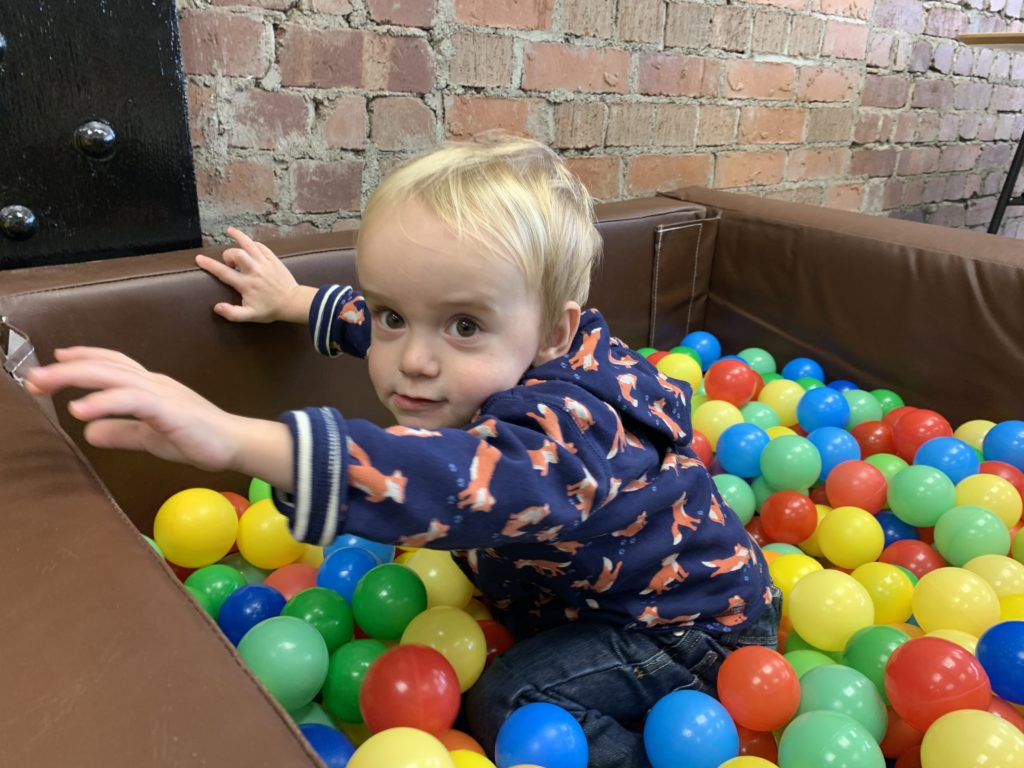 Toddler in a ball pool