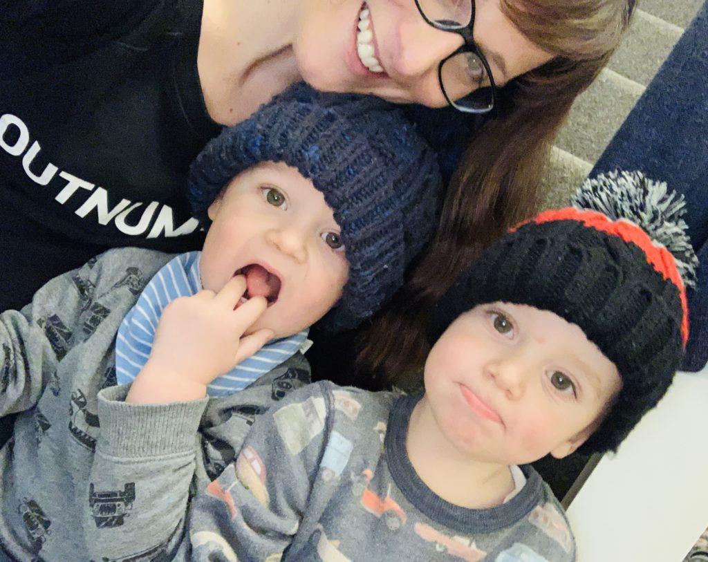 Twins don't like sharing mum's lap