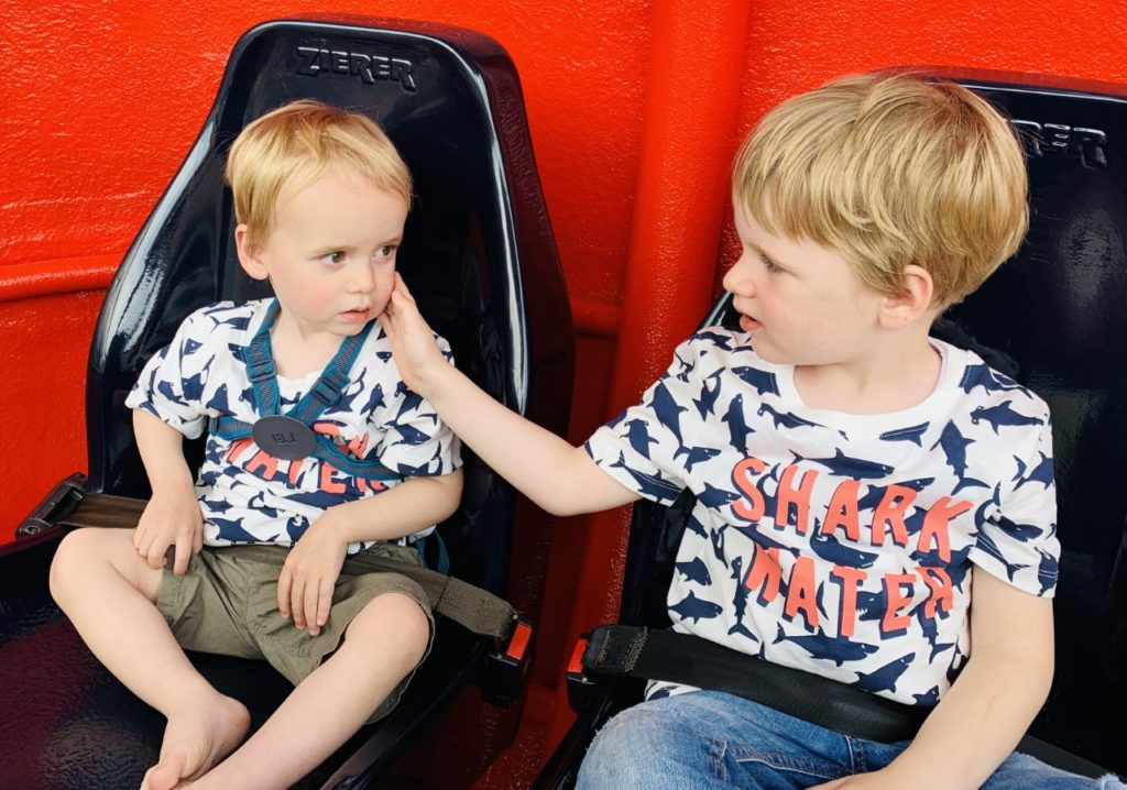 Brothers on the helicopter ride at Peppa Pig World