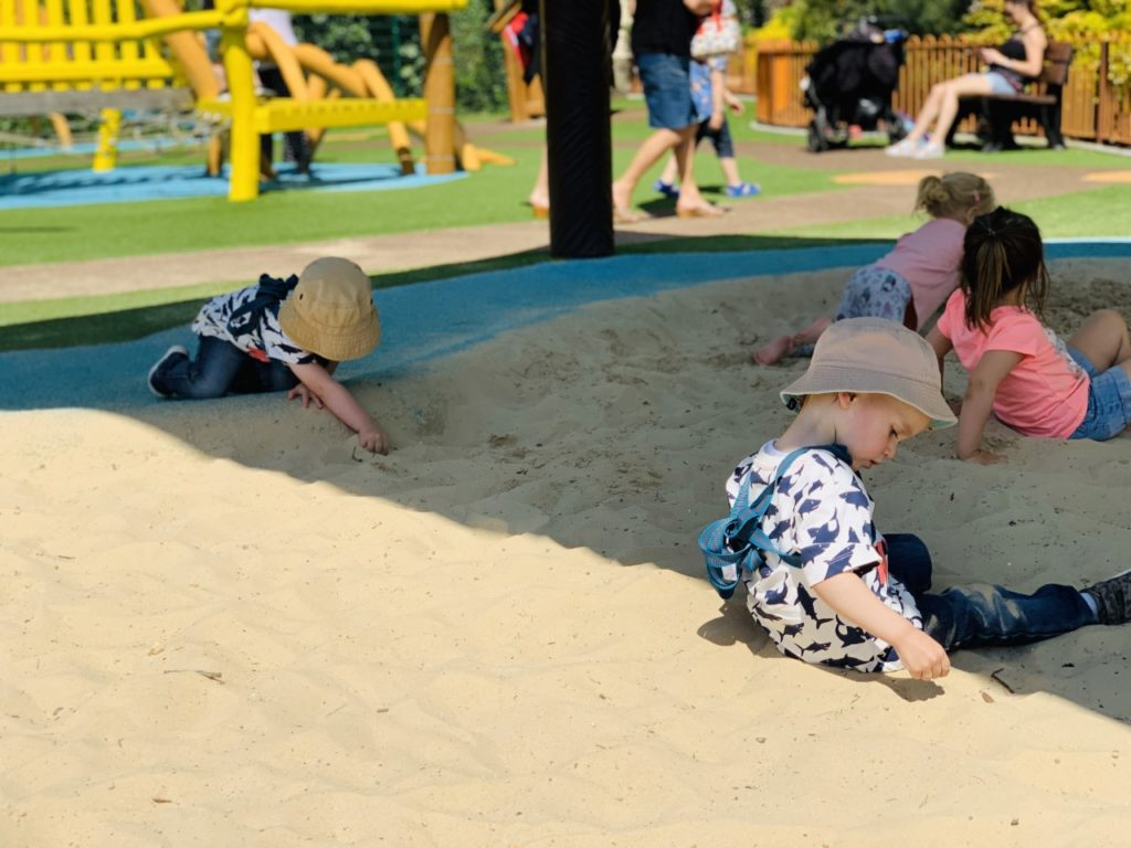 Twins play in the sandpit at Paultons Park