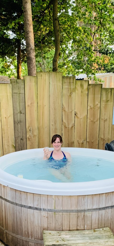 Helen Copson in a hot tub at Sandy Balls holiday park