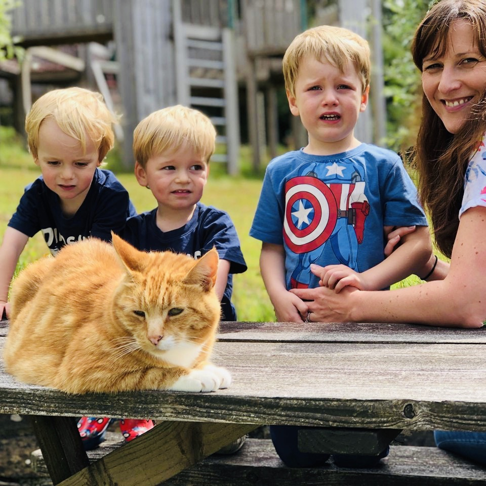 Oscar the cat with the boys and mummy