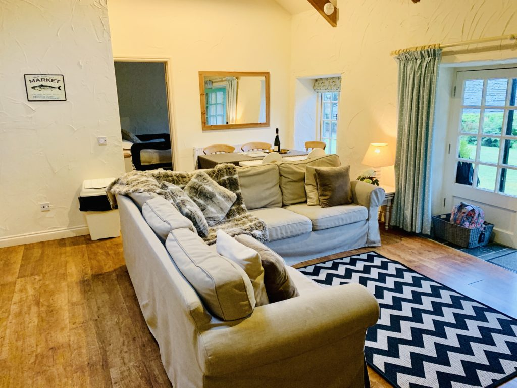 Lounge area of the Old Stables cottage at Glyn Barton