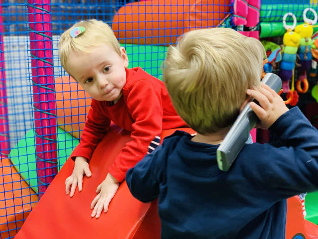 Twins enjoying soft play as a great idea of things to do indoors in Plymouth with kids