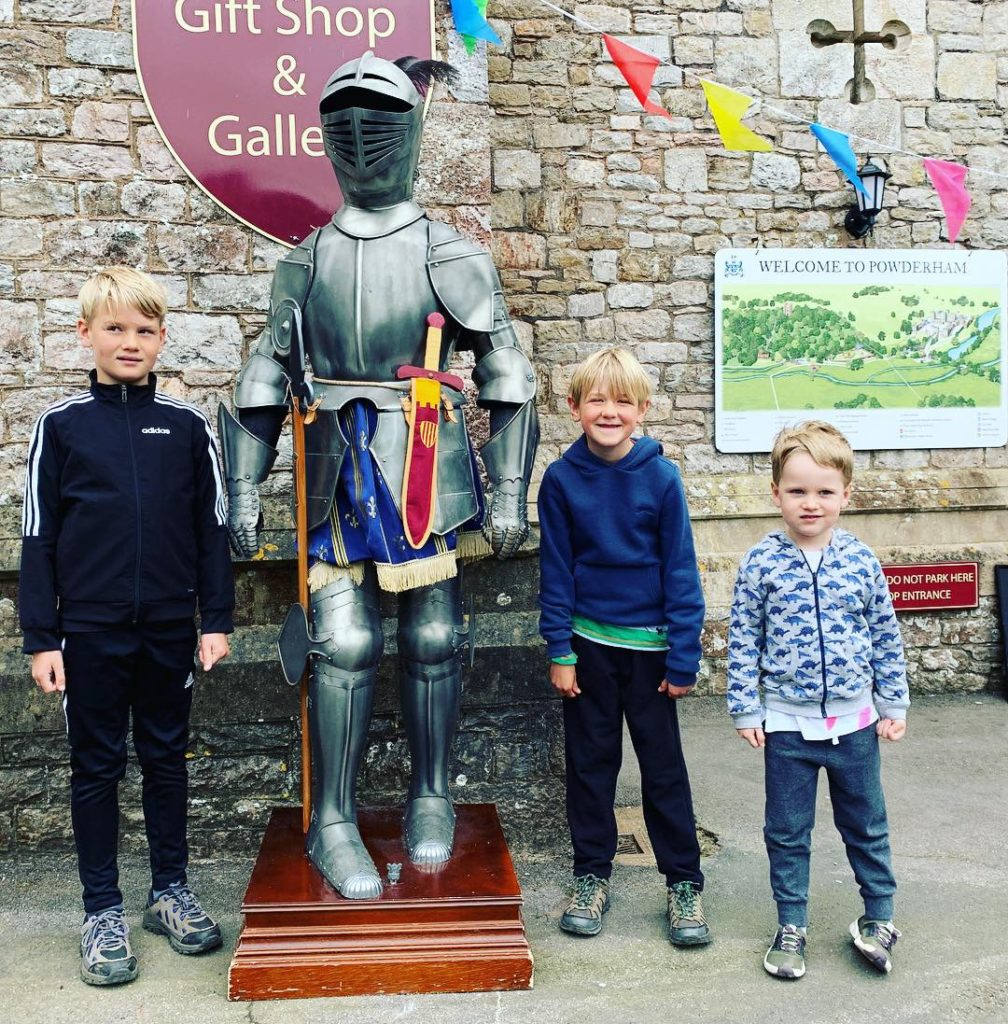 Cousins next to a knight's armour