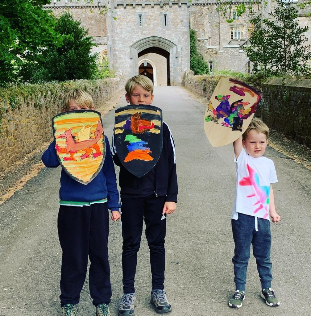 Showing off the shields they painted at Powderham