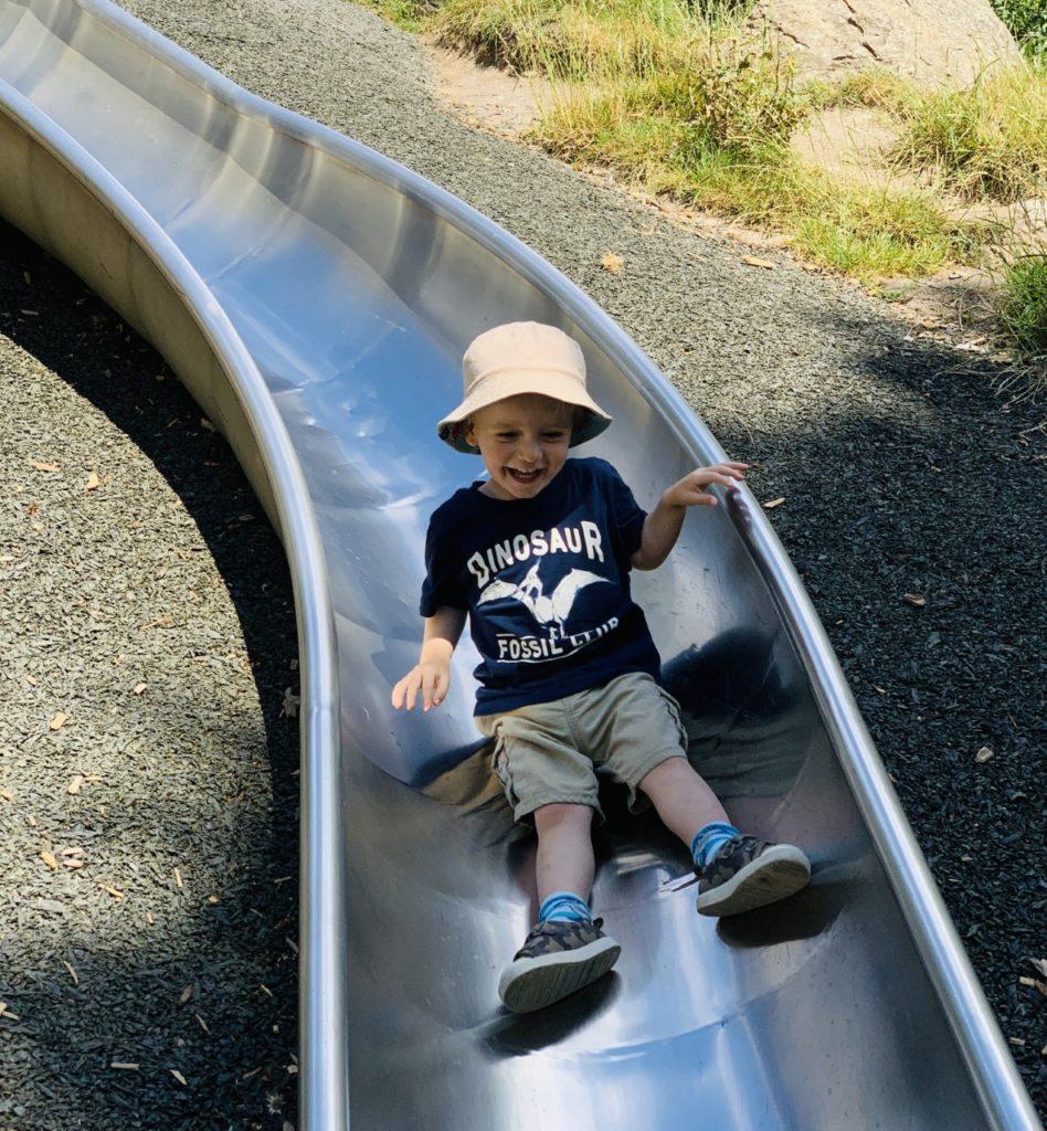 Toddler on the slide at Devonport Park, Plymouth