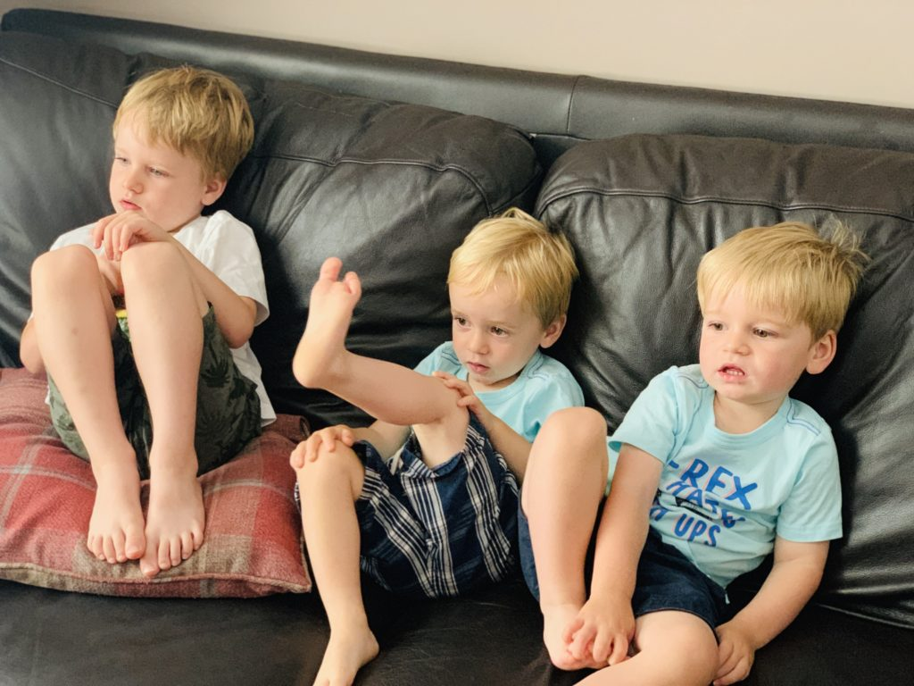 Brothers watching TV during the summer hoildays