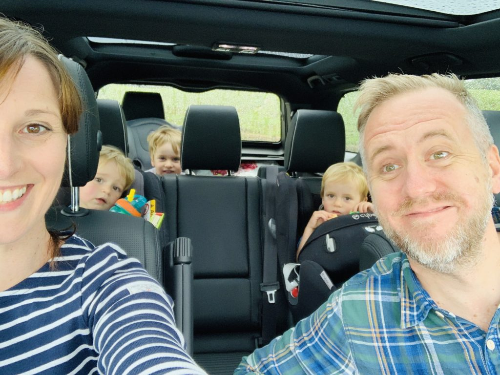 Family test driving a Discovery