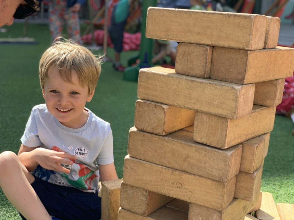 Boy playing giant jenga at Princesshay