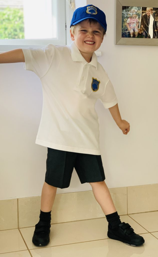 A four year old boy in school uniform