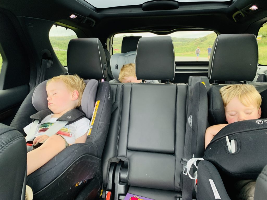 Three young children in the back of a Land Rover Discovery