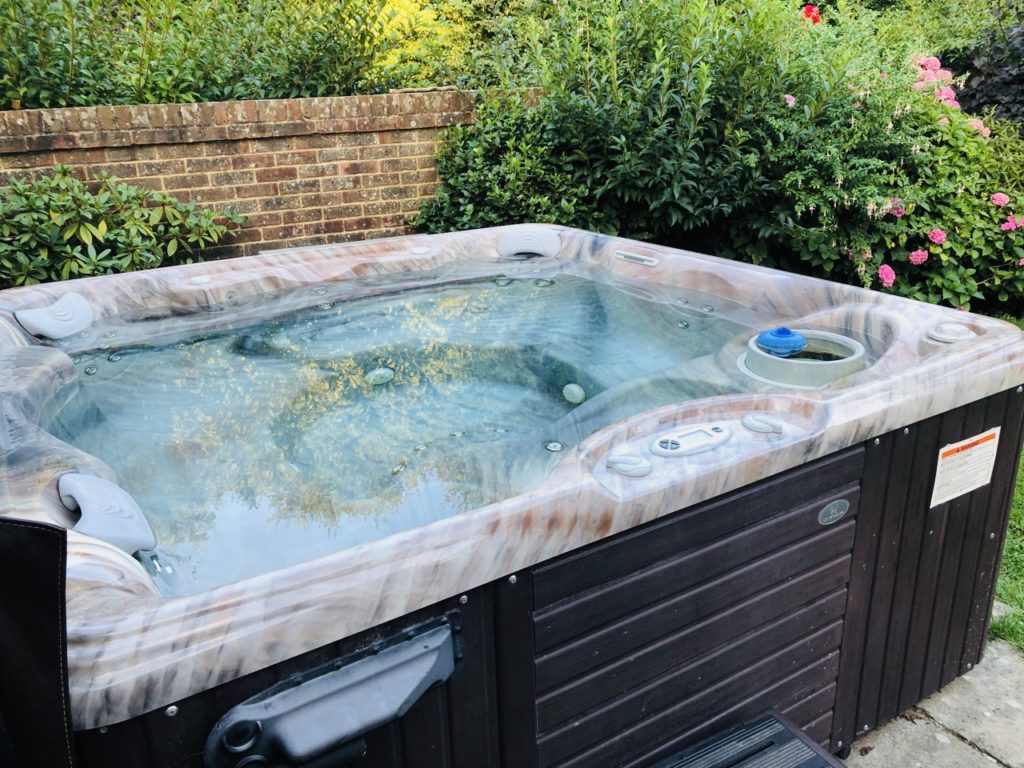 Hot tub in the garden at Greenwood Grange