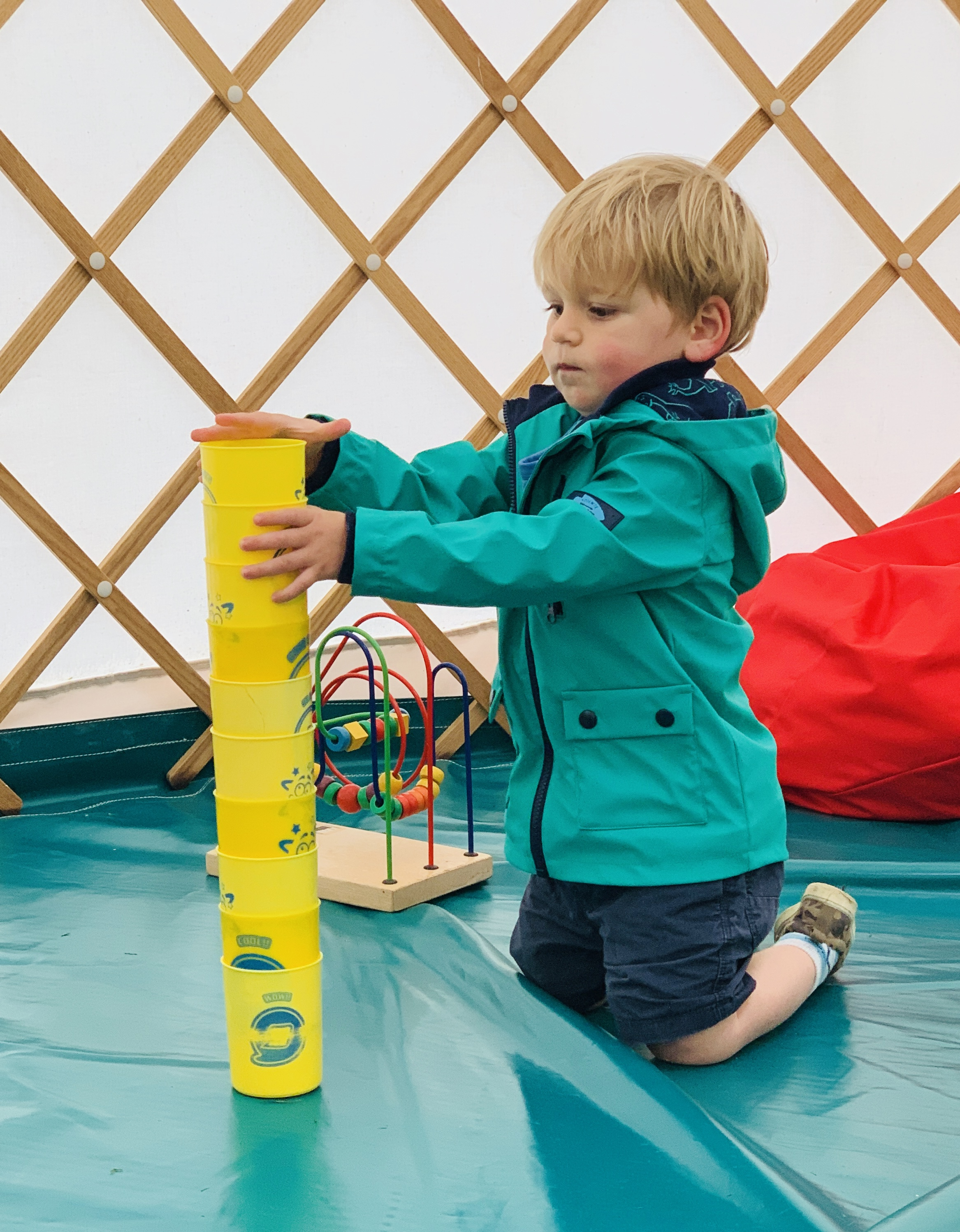 Toddler in the Greenwood Grange play yurt