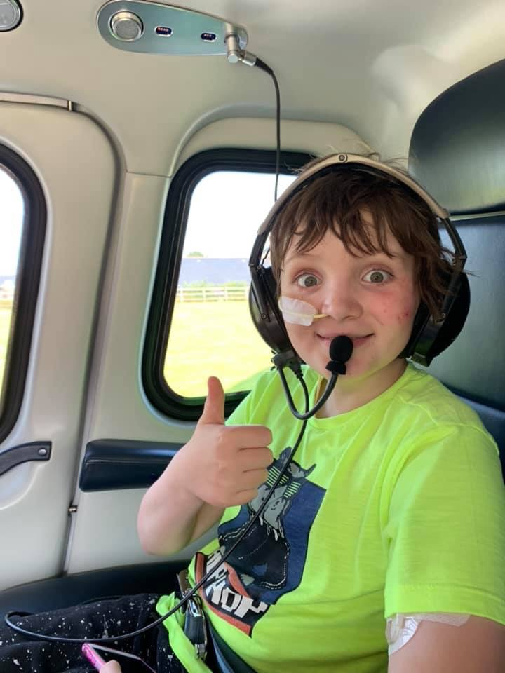 Oliver Brown in a helicopter