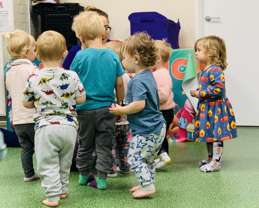 Children queue up for a sticker at Moo Music