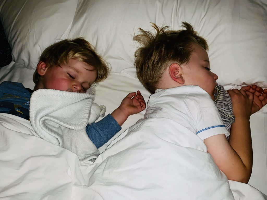 Brothers co-sleeping in parents' bed