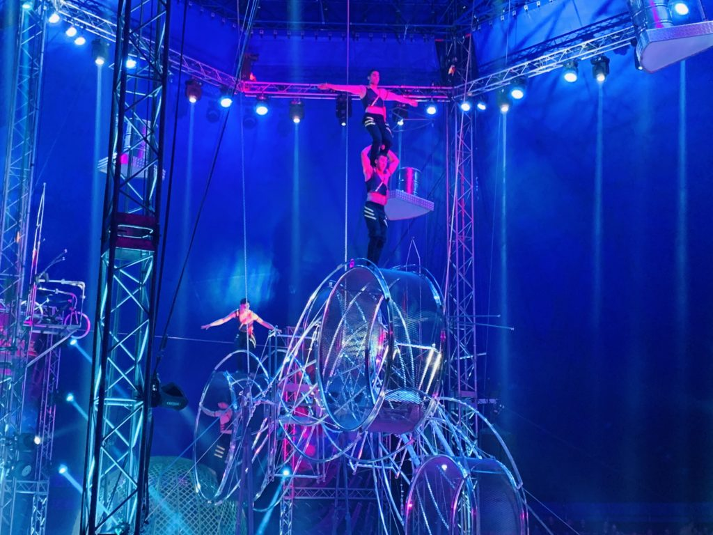 Circus Extreme performers performing on spinning wheels