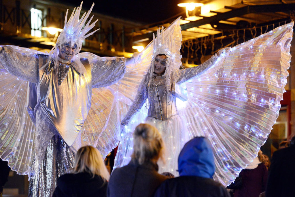Frozen giants at a Christmas lights switch on