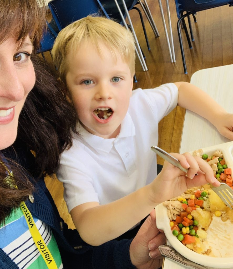Mum and son enjoying a school dinner