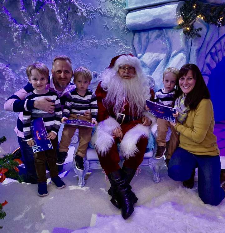 Family with three boys and Santa at Bluestone's Christmasland