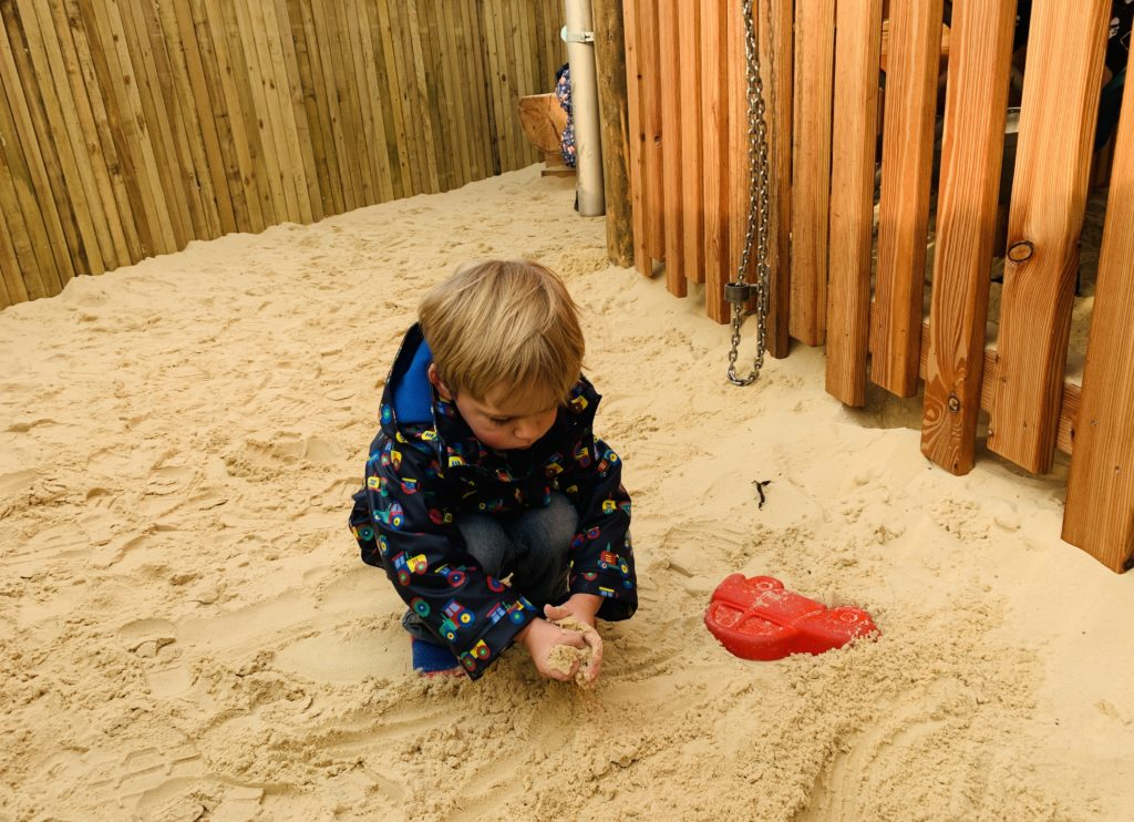 Toddler plays with the sand at Bluestone's Serendome