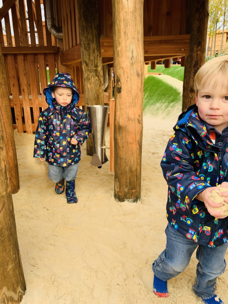 Twin boys play in the sand at Bluestone's Serendome