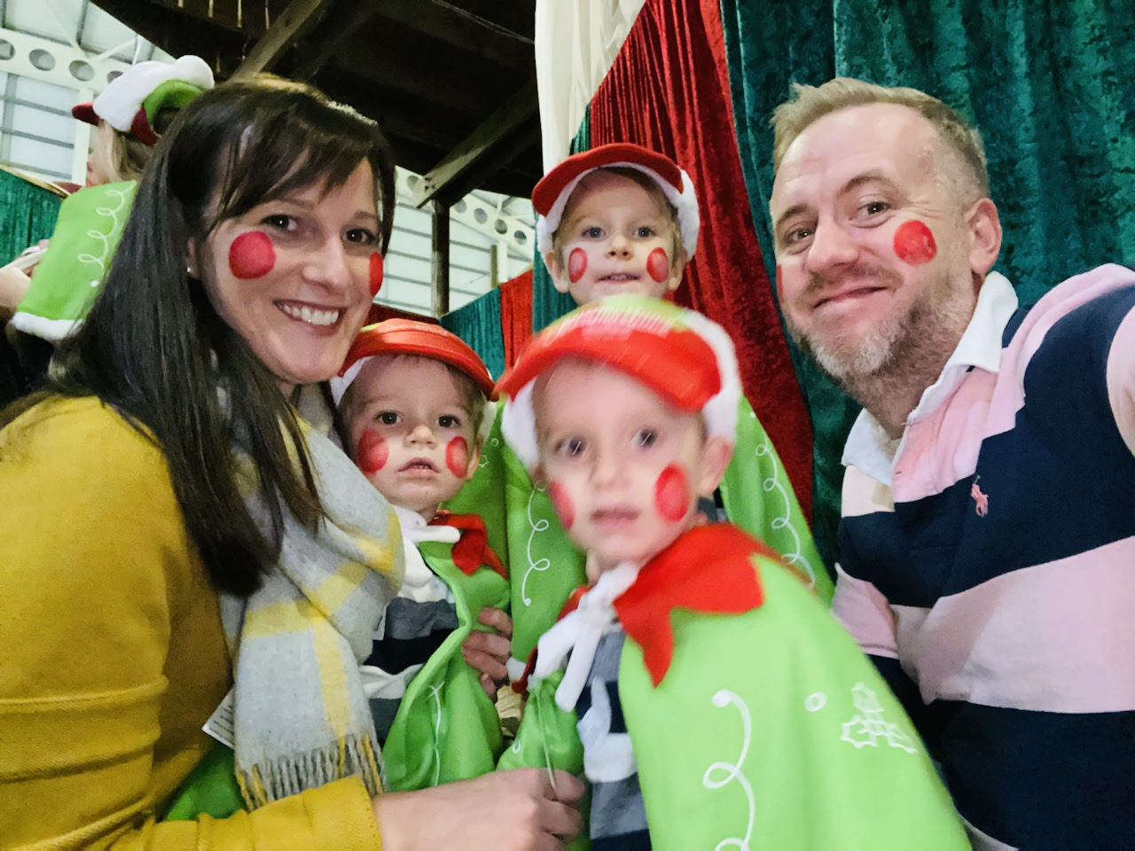 Family dressed as elves at Bluestone's Christmasland