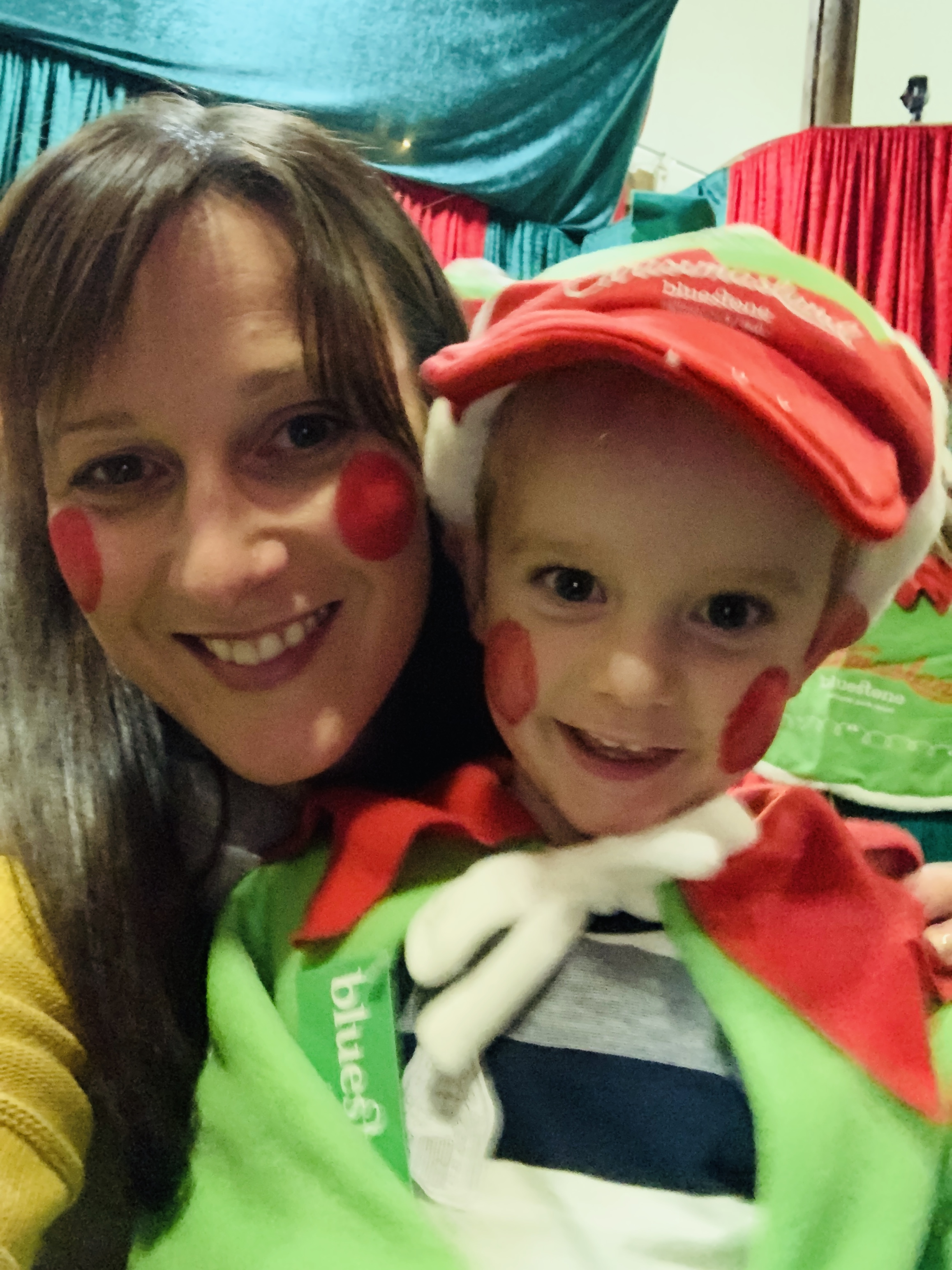 Mum and toddler dressed as elves at Bluetone's Christmasland
