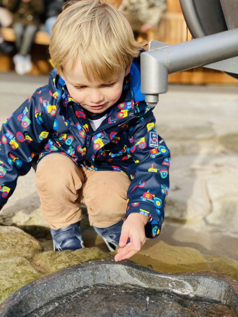Toddler plays in the water at Bluestone's Serendome