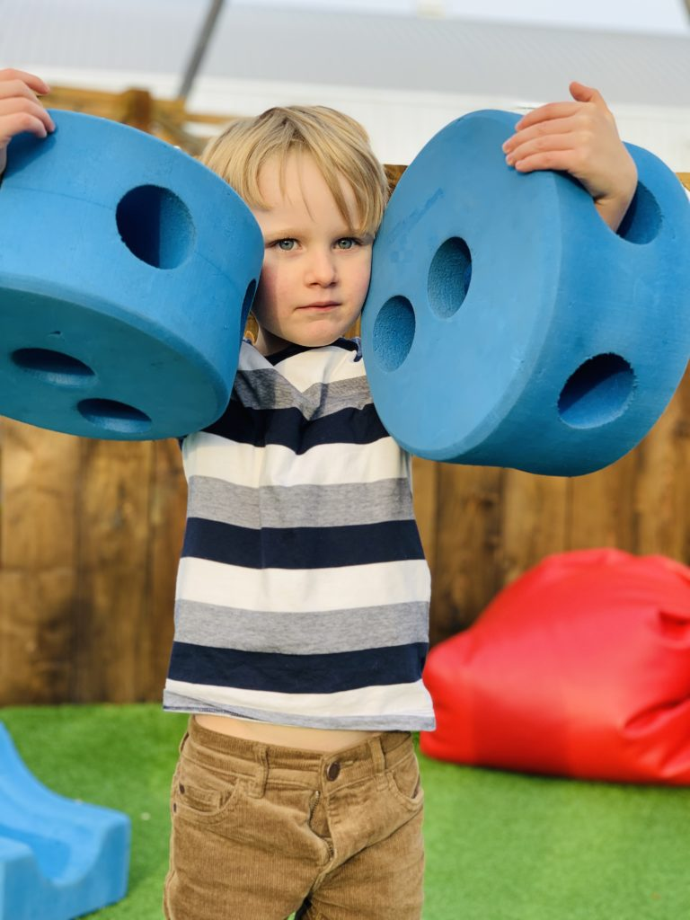 Boy plays with foam blocks at Bluestone's Serendome