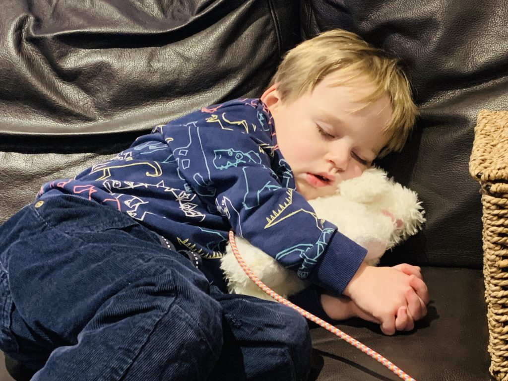 Toddler napping on the settee