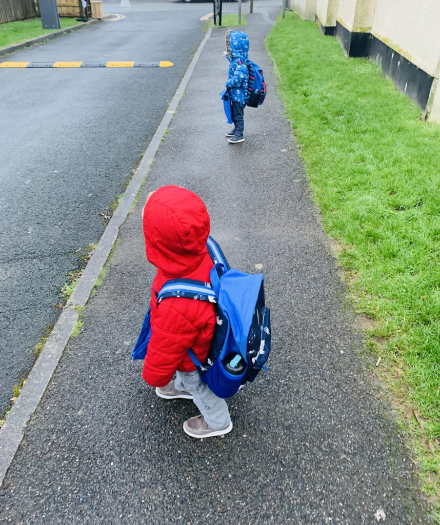 twins walking to preschool