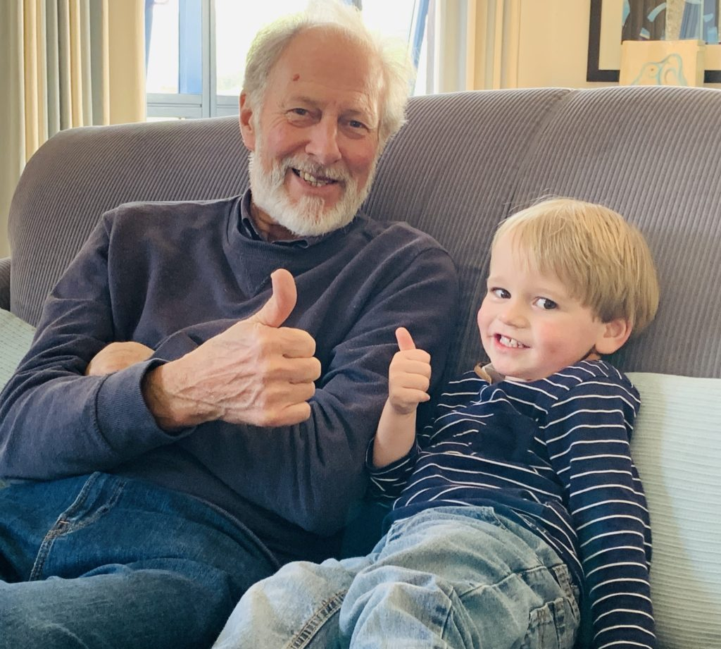 Toddler and Grandad give the thumbs up at The Park, Cornwall