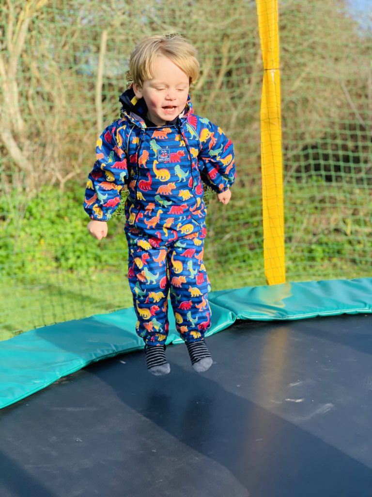 Toddler bouncing on a trampoline